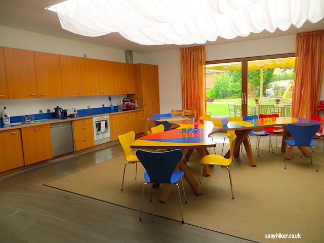 """The Ronald McDonald Gehry House of Oeynhausen and its common kitchen and dining area"""