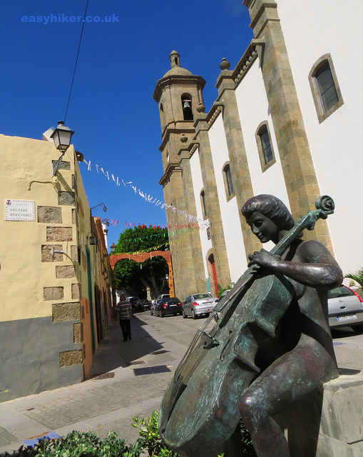 """a statue of a woman playing a cello in Aguimes, one of the towns of Gran Canaria worth a visit"""