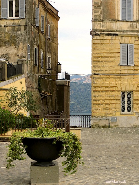 """View of Lake Albano through a small alley of Castel Gandolfo"""