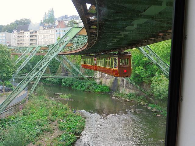 """An old hanging train cabin in Wuppertal's Schwebebahn"""