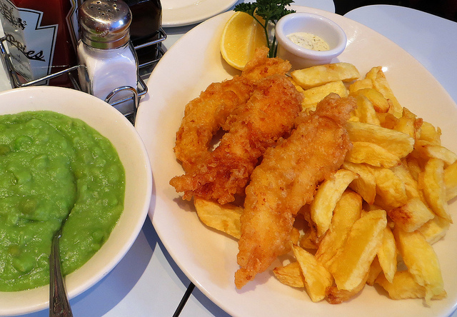 """Fish and chips with a side dish of mushy peas english food on the east end menu"""