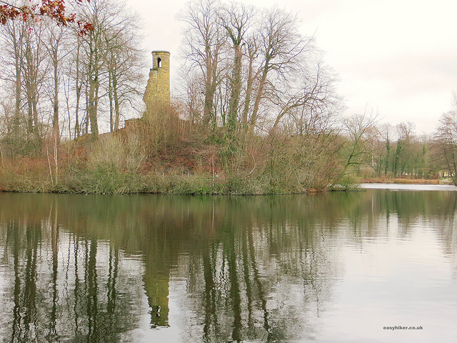 """A castle ruin on an islet in a French rococo garden in Germany"""