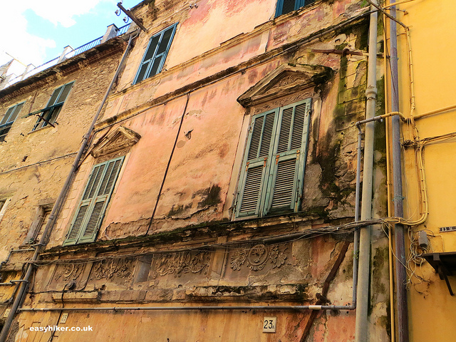 """neglected crumbling old building in Taggia"""