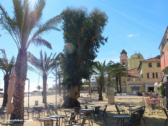 """seaside front cafes in Arma - tale of two towns"""