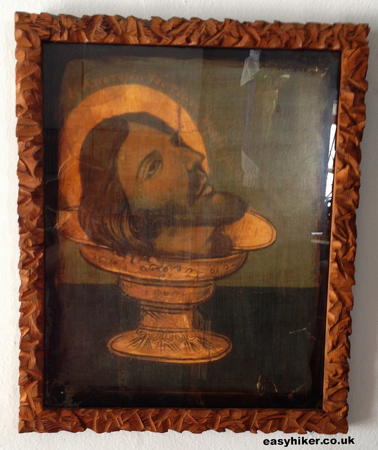 """an icon of St John the Baptist's head inside one of the churches in Ios"""