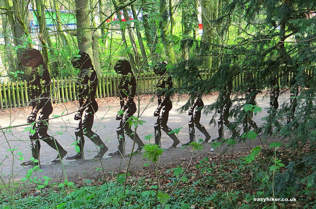 """statues representing development of homo sapiens sapiens on a Neanderthal hike inGermany"""
