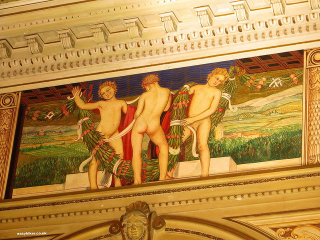 """frescoes on the walls inside a building in Montecatini Terme"""