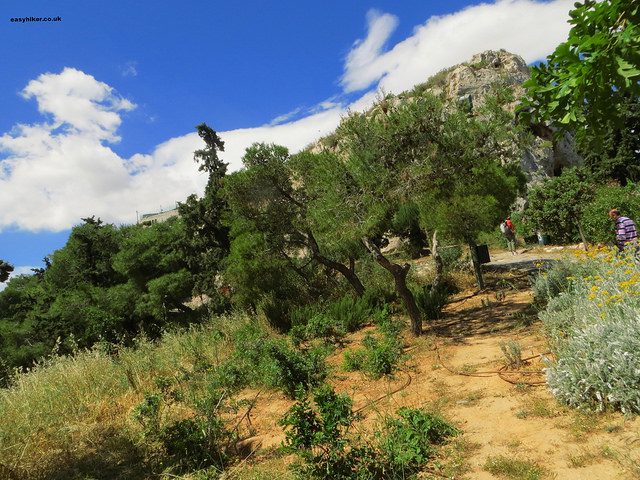 """People going up the highest mountain in Athens - Lycabettus"""