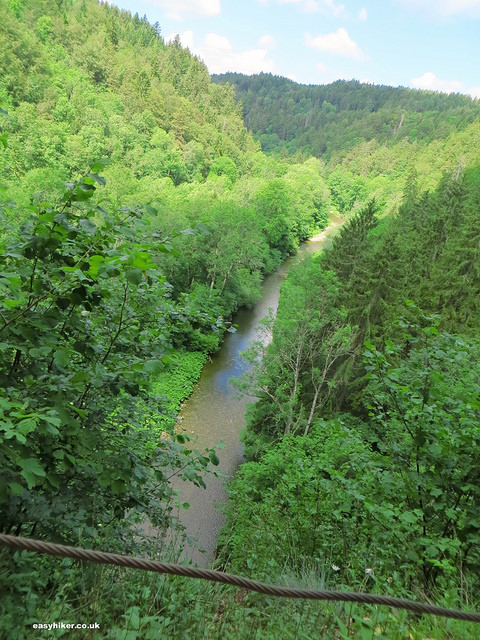 """a river along the Wutach trail of the Black Forest seen from a bridge"""