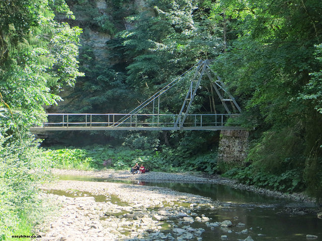 """an abandoned bridge over the river on the Wutach trail in the Black Forest"""