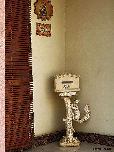 """Statue cum mailbox in front of a house in Gozo, Malta"""