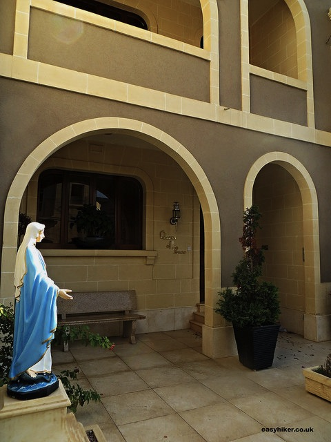 """Statue of the Virgin Mary in a courtyard of a house in Gozo"""
