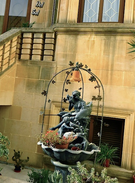 """Classic statue on a fountain in front of a house in Gozo"""