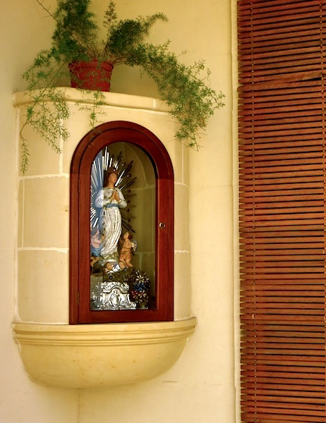 """religious statue in front of a house in Gozo"""