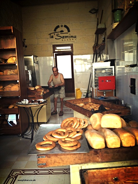 """Baker in bakery Ta' Saminu in Gozo"""