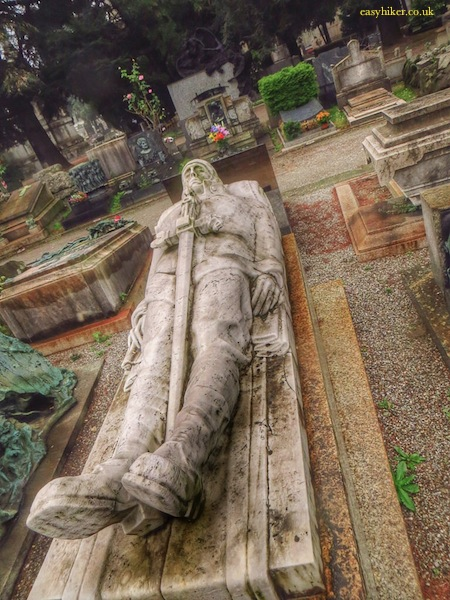 """a statue of a dead knight in Cimitero Monumentale in Milan"""