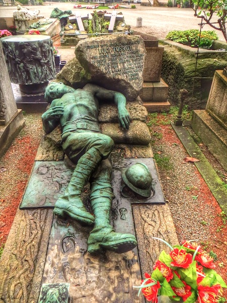 """sculpture of a dead soldier in the Cimitero Monumentale in Milan"""