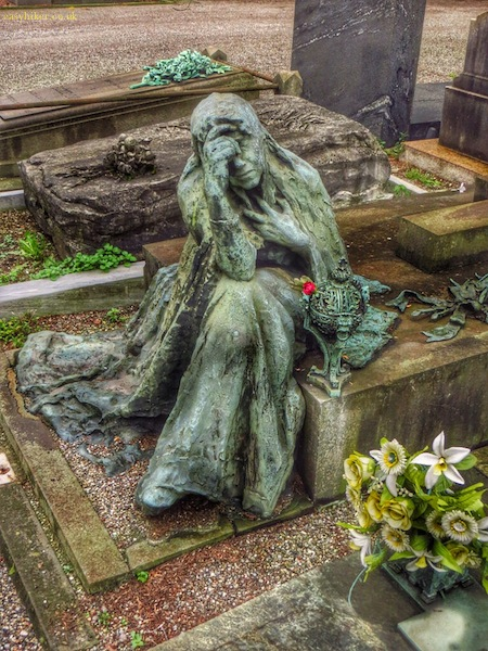 """statue of a grieving wife/mother in Cimitero Monumentale in Milan"""
