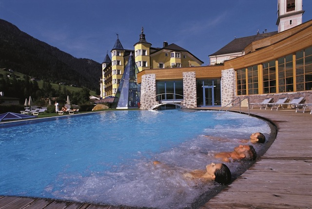 """Relaxing on the pool of Hotel Adler Dolomiti, premier hiking hotel in Val Gardena"""