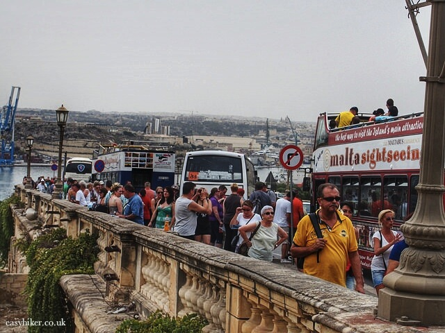 """crowds of bussed tourists arrive in Valletta Malta"""