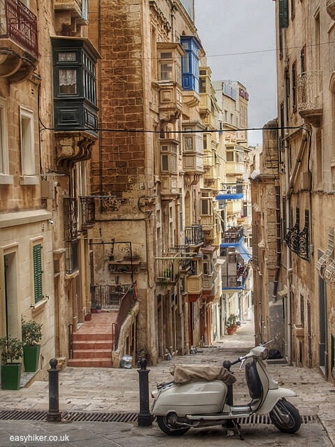 """""""a Vespa on top of a narrow stairway of Valletta in Malta"""""""