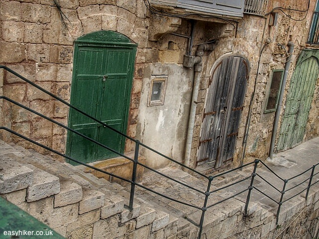 """""""one of the stairways of Valletta leading to a walkway by a river"""""""