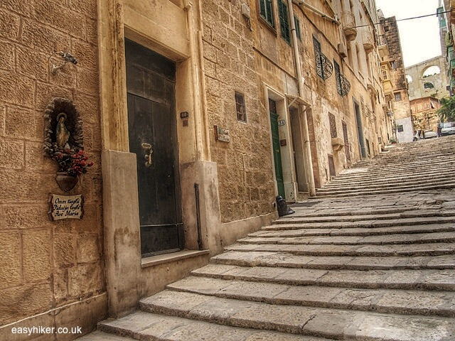 """""""residential buildings lining one of the stairways of Valletta"""""""