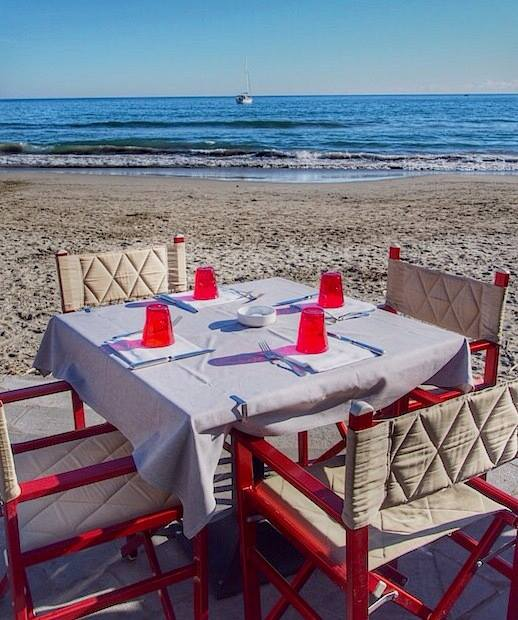 """Table set for lunch before setting of on the perfect winter walk by the beach"""