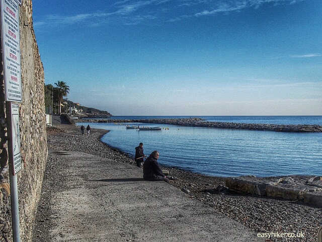 """fishing on the beach of Cervo on the Italian Riviera"""