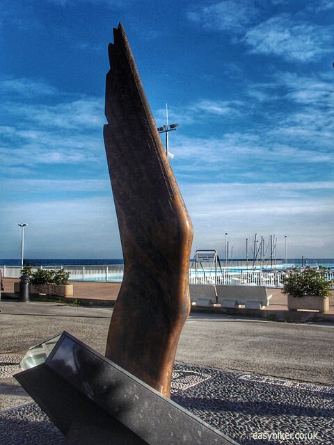 """a monument to dead sailors in the Diano Marina harbour"""