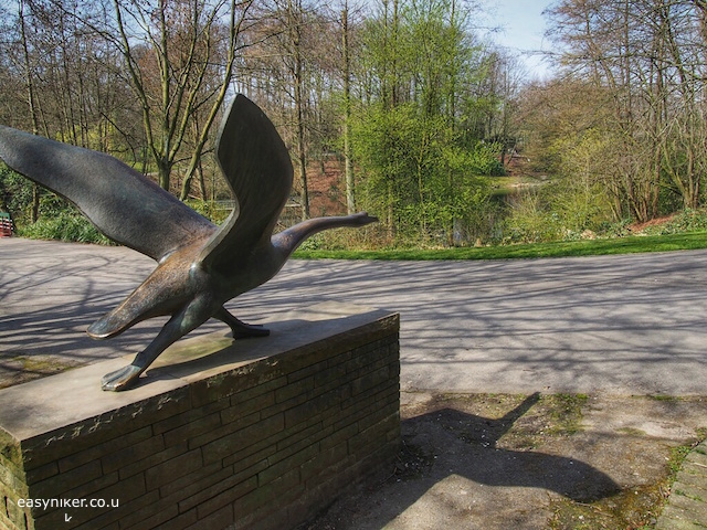 """bronze sculpture of a swan taking flight in Grugapark in Essen"""