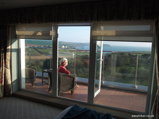 """""""Mrs. Easy Hiker on the balcony of a suite in Thurlestone Hotel"""""""