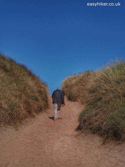 """""""Easy Hiker leaving the sandy beach of South Milton Sands in Thurlestone"""""""