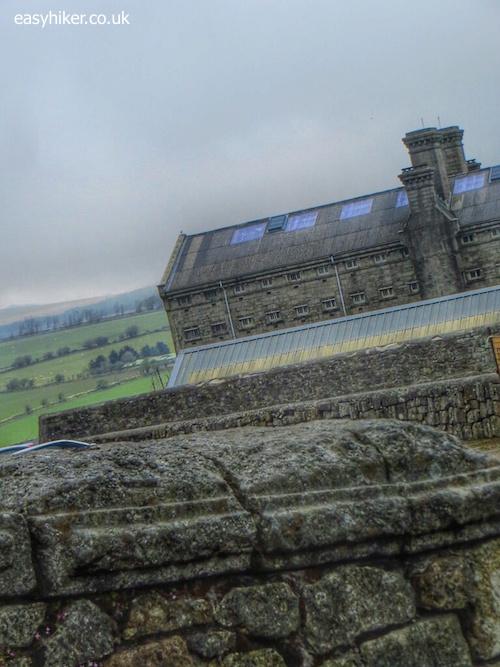"""Bleak house of Dartmoor Prison on a bleak landscape of the Moors"""