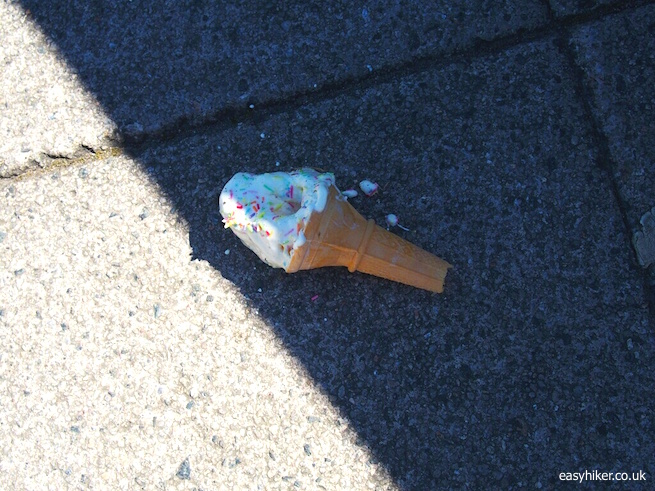 """fallen ice cream cone on the pavement in Plymouth"""