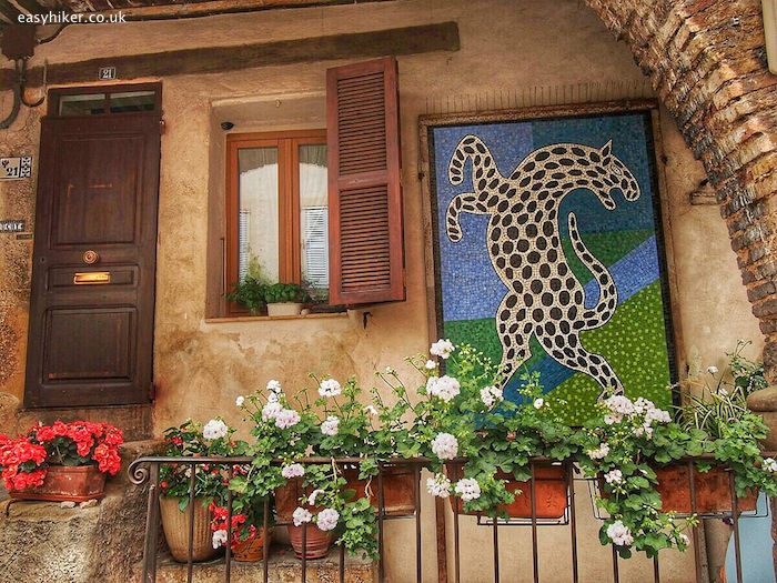 """""""ceramic mural on a house's facade in Biot"""""""
