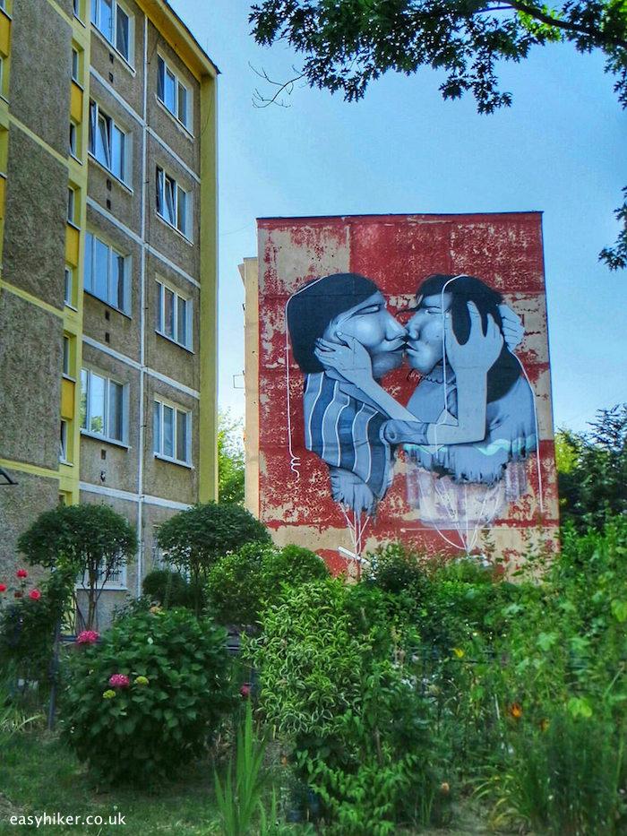 """two men kissing mural in Kosice Slovakia by a Brazilian artist"""
