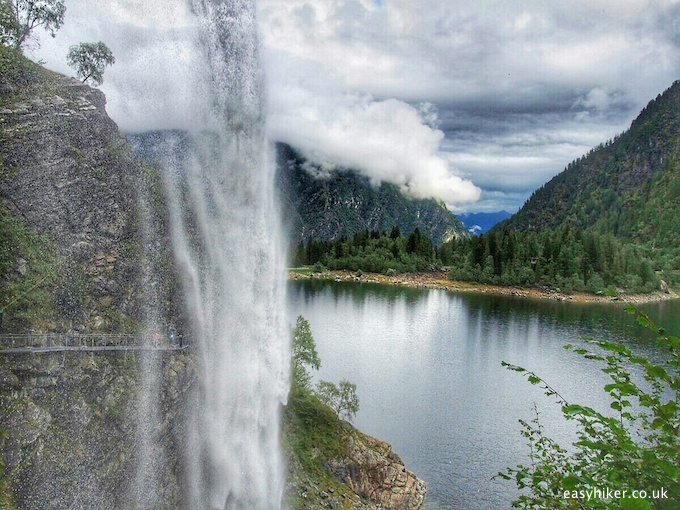 """walking under a waterfall by Lake Antrona in the Ossola valley"""