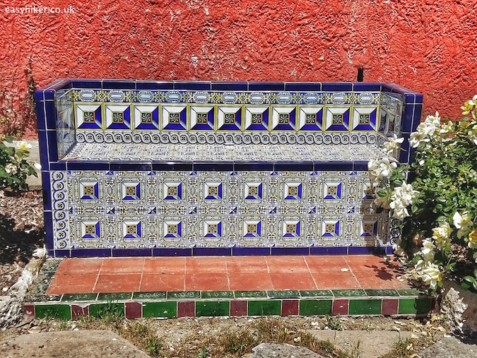 """a mosaic tiled bench inside the gardens of the Fontana Rosa in Menton"""