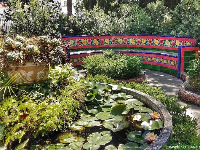 """mosaic tiled bench inside the Glorious Fontana Rosa Garden"""