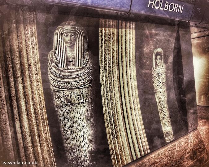 """mummy poster inside Holborn underground station"""