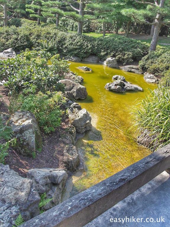 """a bridge in a Zen Japanese garden"""