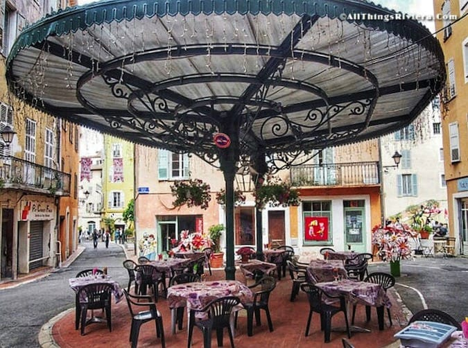 """Tables set outside of a restaurant - Grasse is for inhaling"""